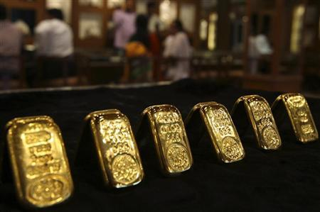 Gold biscuits are displayed inside a jewellery showroom in Hyderabad April 11, 2012. REUTERS/Krishnendu Halder