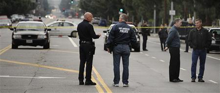 Los Angeles police and robbery homicide detectives investigate the shooting scene where four people were shot and killed in Northridge, California early December 2, 2012. REUTERS/Gene Blevins