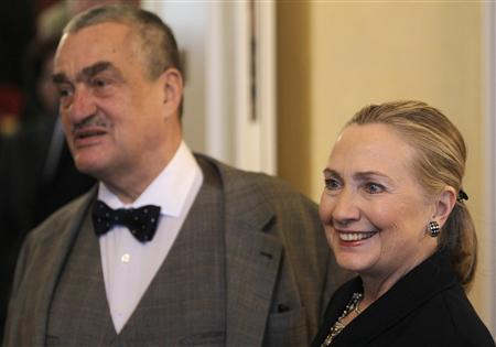 Czech Republic's Foreign Minister Karel Schwarzenberg (L) and U.S. Secretary of State Hillary Clinton arrive for a meeting in Prague December 3, 2012. Clinton will seek to convince Czech leaders of the advantages of picking U.S. firm Westinghouse over a Russian rival as the contractor for a $10 billion nuclear reactor project in meetings in Prague on Monday. REUTERS/David W Cerny