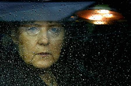 File photo of Germany's Chancellor Angela Merkel arriving at the European Union (EU) council headquarters for an EU leaders summit in Brussels November 23, 2012. REUTERS/Francois Lenoir/Files