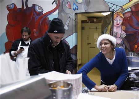 Small-business owners Ralph Gorham (C) and Susan Povich (R) prepare for a delivery of live lobsters at their shop ''Redhook Lobster Pound'' in New York December 16, 2010. REUTERS/Lucas Jackson