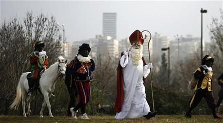 A performer dressed as Sinterklaas (St. Nicholas) arrives to deliver presents to children during a festival organised by the Dutch embassy in downtown Sofia, December 5, 2009. REUTERS/Stoyan Nenov/Files