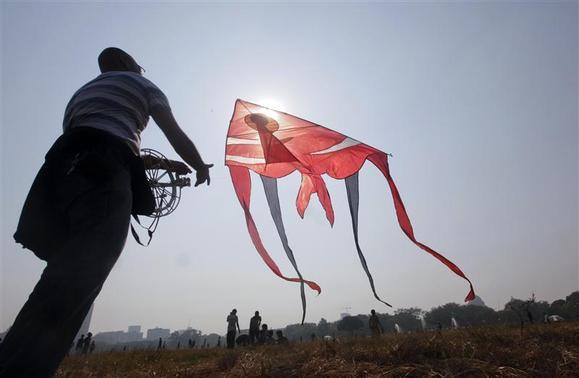 A man flies a giant kite at a park in Kolkata December 2, 2012. REUTERS/Rupak De Chowdhuri/Files