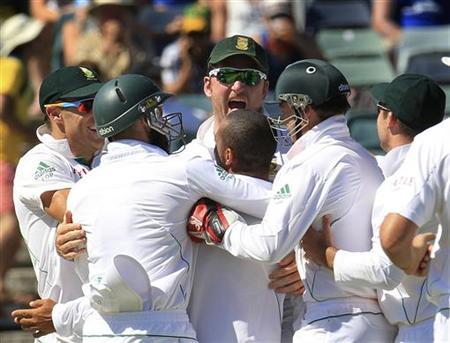 South Africa's captain Graeme Smith (C) celebrates the wicket of Australia's Matthew Wade with team mates at the WACA during the fourth day's play of the third test cricket match in Perth December 3, 2012. REUTERS/Stringer