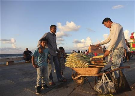 A man sells corn by the beach in Benghazi October 5, 2012. REUTERS/Esam Al-Fetori/Files