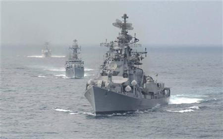 Naval warships form a line during an exercise in the waters of Bay of Bengal in Chennai January 24, 2010. REUTERS/Babu/Files