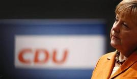 German Chancellor and leader of Germany's Christian Democratic Union (CDU), Angela Merkel addresses the media after inspecting the convention hall one day ahead of the CDU's annual party meeting in Hanover, December 3, 2012. 1001 delegates are expected to elect party leader and German Chancellor Angela Merkel as top candidate for Germany's 2013 general elections during the three day party convention. REUTERS/Kai Pfaffenbach (GERMANY - Tags: POLITICS)