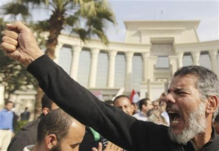 A supporter of Egypt's President Mohamed Mursi gestures during a rally in front of the Supreme Constitutional Court in Maadi, south of Cairo, December 2, 2012. Protests by Islamists allied to Mursi forced Egypt's highest court to adjourn its work indefinitely on Sunday, intensifying a conflict between some of the country's top judges and the head of state. REUTERS/Amr Abdallah Dalsh (EGYPT - Tags: POLITICS CIVIL UNREST)