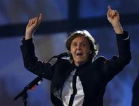 Former Beatle Paul McCartney sings during the opening ceremony of the London 2012 Olympic Games at the Olympic Stadium July 27, 2012. REUTERS/Pool