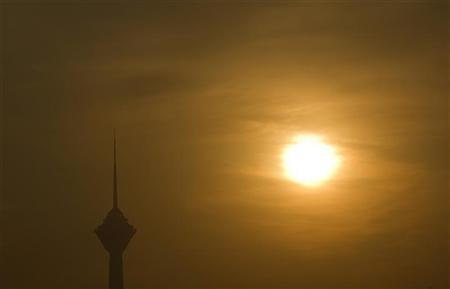 The Milad communications tower is seen through pollution in Tehran December 8, 2010. REUTERS/Caren Firouz