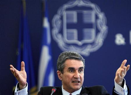 Greece's then Labour Minister Andreas Loverdos addresses reporters during a news conference in Athens in this file June 25, 2010 photo. REUTERS/John Kolesidis