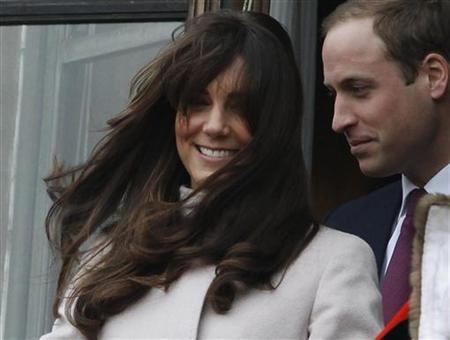 The new hairstyle of Catherine, Duchess of Cambridge is blown by the wind during a visit with Prince William (R) to Cambridge, central England November 28, 2012. REUTERS/Luke MacGregor