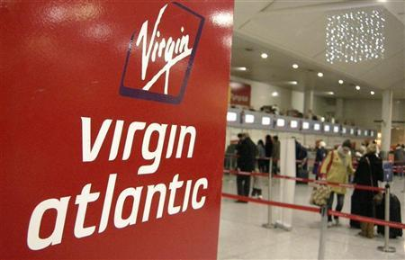 A Virgin Atlantic logo is seen at check-in desks at Gatwick airport, in southern England December 21, 2007. REUTERS/Alessia Pierdomenico (BRITAIN)