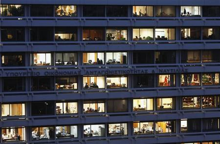 Employees are seen working in their offices in the building housing Greece's finance and development ministries in Athens November 29, 2012. REUTERS/John Kolesidis