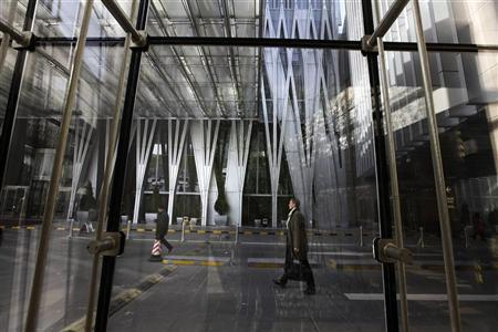 People walk at the China World Trade Center in Beijing's central business district, November 29, 2012. REUTERS/Jason Lee
