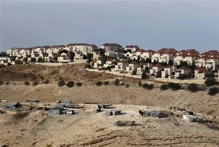 A Bedouin encampment of the Jahalin tribe is seen in front of the Jewish settlement of Maale Adumim, near Jerusalem December 3, 2012. REUTERS/Ammar Awad
