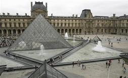 General view of the Louvre Museum with its glass Pyramid entrance designed by Chinese-born U.S. Architect I.M. Pei, in Paris, August 6, 2007. REUTERS/Regis Duvignau