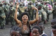 People dance to celebrate government army FARDC soldiers return to Goma December 3, 2012. REUTERS/Goran Tomasevic