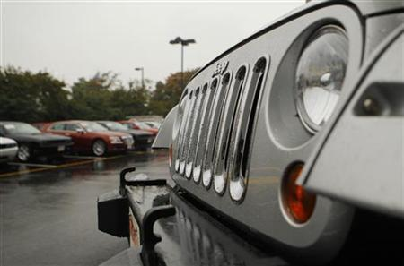 A Jeep Wrangler (R) is shown at the Criswell Chrysler-Dodge-Jeep-Fiat dealership in Gaithersburg, Maryland October 2, 2012. REUTERS/Gary Cameron