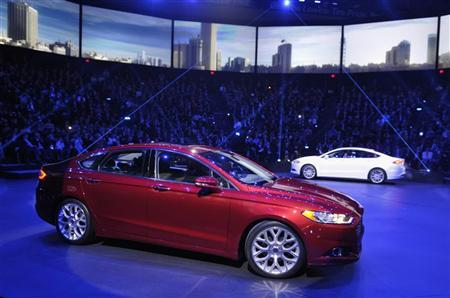 A pair of 2013 Ford Fusions make their debuts on the first press preview day for the North American International Auto Show in Detroit, Michigan, January 9, 2012. REUTERS/Mike Cassese