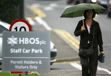 A worker leaves HBOS offices, in Edinburgh, Scotland on September 18, 2008. REUTERS/David Moir