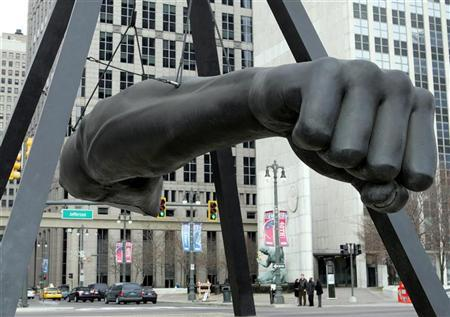 The Joe Louis 'Fist' sculpture hangs from a pyramid shaped support in downtown Detroit, Michigan January 27, 2006.