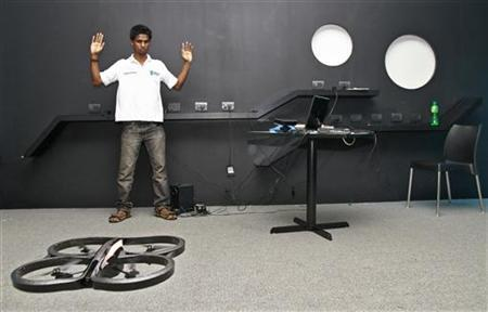 Vivek, an engineering student, demonstrates as he tries to control a Quad-copter with his hand at the Start-up Village in Kinfra High Tech Park in Kochi October 13, 2012. REUTERS/Sivaram V