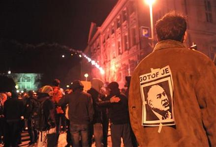 A protester wears a picture of Maribor's Mayor Franc Kangler, which reads: ''You are finished'', during a demonstration in Maribor December 3, 2012. REUTERS/Srdjan Zivulovic