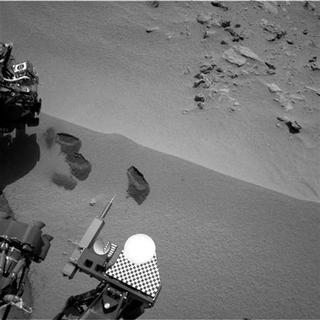 Three bite marks left in the Martian ground by the scoop on the robotic arm of NASA's Mars rover Curiosity are pictured in this October 15, 2012 NASA handout photo obtained by Reuters October 20, 2012. REUTERS/NASA/JPL-Caltech/Handout