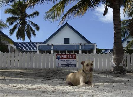 A dog sits outside of the home of anti-virus software pioneer John McAfee in San Pedro November 14, 2012. REUTERS/Henry Romero