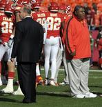 Kansas City Chiefs head coach Romeo Crennel (R) and general manager Scott Pioli watch their team before the start of their NFL football game against the Carolina Panthers in Kansas City, Missouri December 2, 2012. REUTERS/Dave Kaup