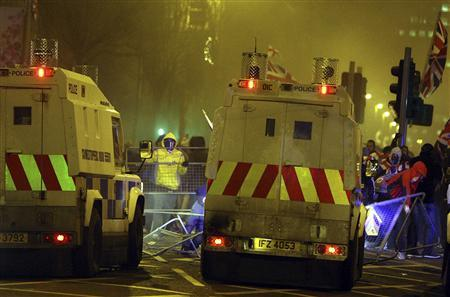 Loyalists clash with police officers outside the City Hall in Belfast, following a vote by local councillors on the flying of the Union Flag on top of the City Hall, December 3, 2012. REUTERS/STRINGER