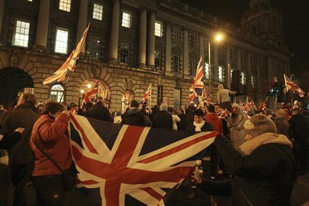 Loyalists clash with police officers outside the City Hall in Belfast following a vote by local councillors on the flying of the Union Flag on top of the City Hall, December 3, 2012. REUTERS/Stringer