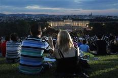 A couple take a photo as they attend the Summer Night Concert (Sommernachtskonzert) of the Vienna Philharmonic Orchestra (Wiener Philharmoniker) in Vienna June 7, 2012. REUTERS/Lisi Niesner