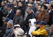 Voters listen to a speech by Japan's main opposition Liberal Democratic Party (LDP) leader and former Prime Minister Shinzo Abe at an official campaign kick-off for the December 16 lower house election, in Fukushima, northern Japan December 4, 2012. Abe started his party's campaign for the election kick-off on Tuesday from Fukushima prefecture, where the world's worst nuclear accident in 25 years hit the region after being triggered by a 9.0-magnitude earthquake and massive tsunami on March 11, 2011. REUTERS/Issei Kato