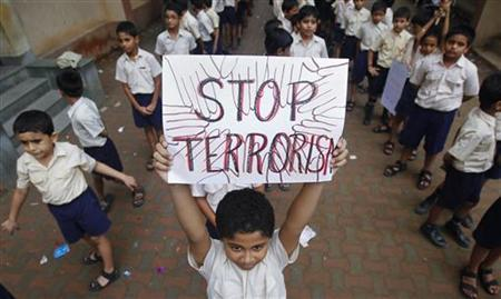 A student lifts a placard as he and others line up to take part in a march for peace in Mumbai July 20, 2011. REUTERS/Danish Siddiqui