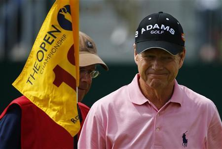 Tom Watson of the U.S. smiles as he walks off the 18th green during the third round of the British Open golf championship at Royal Lytham & St Annes, northern England July 21, 2012. REUTERS/Eddie Keogh