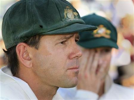 Australia's captain Michael Clarke (R) stands beside teammate Ricky Ponting as he gives an interview at the WACA after the third test cricket match against South Africa, in Perth December 3, 2012. REUTERS/Stringer