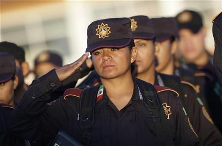 Cadets of the Fuerza Civil (Civil Force) stand in formation during a graduation ceremony in Monterrey October 2, 2012. REUTERS/Daniel Becerril