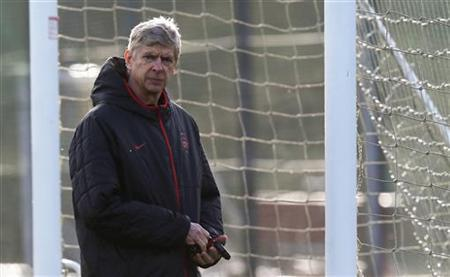 Arsenal manager Arsene Wenger attends a team training session in London Colney, north of London December 3, 2012. REUTERS/Eddie Keogh