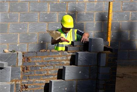 A worker lays bricks for a residential home at a building site in north London September 6, 2012. REUTERS/Neil Hall