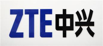 A ZTE company logo is seen at the company's exhibition pavilion during the CommunicAsia information and communications technology trade show in Singapore June 19, 2012. REUTERS/Tim Chong