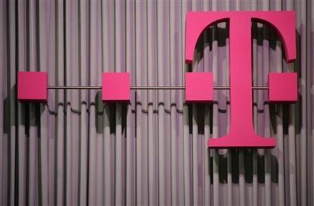 Logo of German company Deutsche Telekom is pictured at the CeBit computer fair in Hanover, March, 6, 2012. The biggest fair of its kind will run to March 10, 2012. REUTERS/Fabian Bimmer (GERMANY - Tags: BUSINESS TELECOMS SCIENCE TECHNOLOGY LOGO)