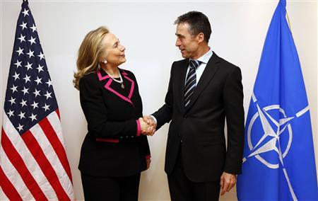 U.S. Secretary of State Hillary Clinton (L) shakes hands with NATO Secretary-General Anders Fogh Rasmussen at the NATO headquarters in Brussels December 4, 2012. REUTERS/Kevin Lamarque