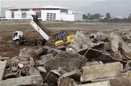 Trucks are pictured at the work site of the Parque Olimpico Rio 2016 (Rio 2016 Olympic Park), which is been constructed over the former Jacarepagua race track, during a press tour in Rio de Janeiro November 20, 2012. REUTERS/Ricardo Moraes