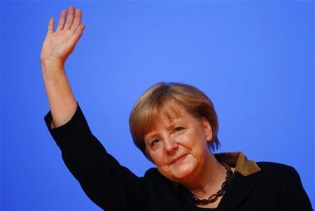 German Chancellor and leader of Germany's Christian Democratic Union (CDU), Angela Merkel acknowledges the applause of the delegates after her speech at the CDU's annual party meeting in Hanover, December 4, 2012. REUTERS/Kai Pfaffenbach