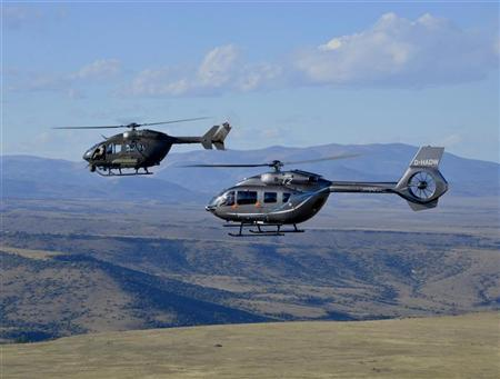Two variants of the European Aeronautic Defence and Space Company (EADS) North America Inc's UH-72A Lakota Light Utility Helicopter fly over the mountains around Alamosa, Colorado, in this handout image released to Reuters on October 18, 2012. REUTERS/James Darcy/EADS North America/Handout