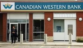 A customer walks out of a Canadian Western Bank branch in Calgary, Alberta June 9, 2009. REUTERS/Todd Korol