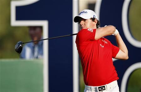 Rory McIlroy of Northern Ireland watches his shot from the 18th tee during the final round of the DP World Tour Championship at Jumeirah Golf Estates in Dubai November 25, 2012. REUTERS/Nikhil Monteiro
