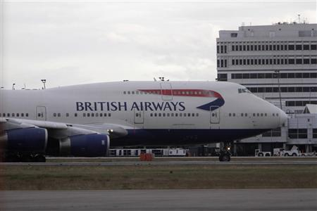 A British Airways Boeing 747 carrying Amanda Knox taxis to the terminal after landing at Seattle-Tacoma International Airport in Sea-Tac, Washington October 4, 2011. REUTERS/Robert Sorbo
